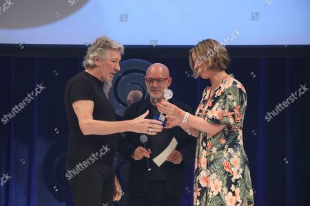 Brian Eno presents Roger Waters with the O2 Silver Clef Award on stage during The Nordoff Robbins O2 Silver Clef Awards 2018.
