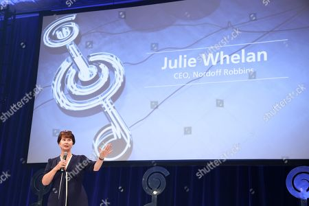 Julie Whelan (Nordoff Robbins CEO) on stage during The Nordoff Robbins O2 Silver Clef Awards 2018.