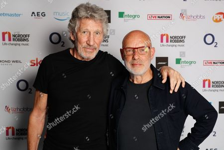 Roger Waters and Brian Eno poses backstage during The Nordoff Robbins O2 Silver Clef Awards 2018.