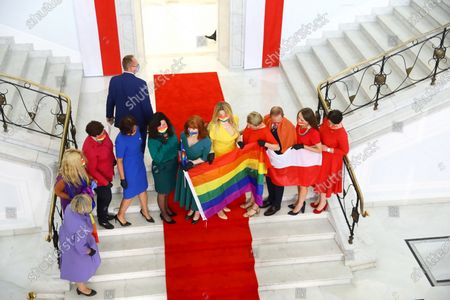 Left-wing Opposition MPs wear outfits in rainbow colors as they attend the swearing-in ceremony before the National Assembly of the Republic of Poland, a joint session of the Sejm (lower house) and Senate in Warsaw, Poland, 06 August 2020. President Andrzej Duda will start a second term after winning the presidential election held on 12 July, in which he defeated Rafal Trzaskowski, the candidate of the Civic Coalition.