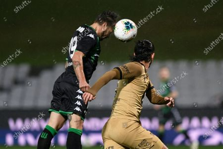 Josh Risdon of Western United rises above Daniel Georgievski of Western Sydney Wanderers to win the header and score the opening goal of the game in the 6th minute; Jubilee Oval, Sydney, New South Wales, Australia; A League Football, Western United FC versus Western Sydney Wanderers.