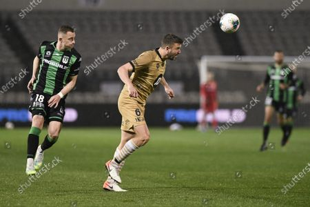 Stock Picture of Matthew Jurman of Western Sydney Wanderers heads the ball clear as Besart Berisha of Western United closes in; Jubilee Oval, Sydney, New South Wales, Australia; A League Football, Western United FC versus Western Sydney Wanderers.