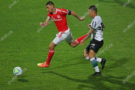 Patrick Vieira of Coritiba chases the run from Thiago Galhardo of Internacional; Couto Pereira Stadium, Curitiba, Parana, Brazil; Brazilian Series A, Coritiba versus Internacional.