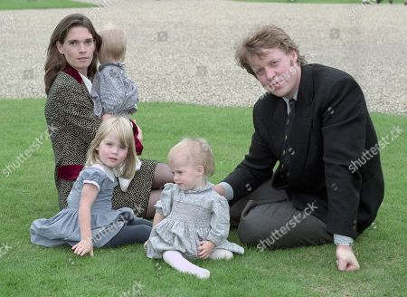 Earl Spencer, Earl Spencer, pictured with his first wife Victoria Aitken and their three children Kitty]; Eliza and Amelia