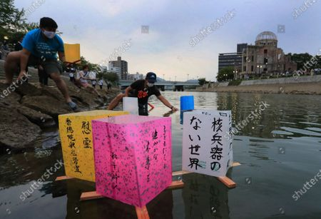 People float paper lanterns on the Motoyasu River near the Atomic Bomb Dome (R, rear) at the Peace Memorial Park in prayer for the victims of the 1945 atomic bombing in Hiroshima, western Japan, 06 August 2020. Japan marks on 06 August 2020 the 75th anniversary of the bombing of Hiroshima. In 1945 the United States dropped two nuclear bombs over the cities of Hiroshima and Nagasaki on 06 and 09 August respectively, killing more than 200,000 people. This year's commemoration events were either canceled or scaled down amid the ongoing coronavirus disease (COVID-19) pandemic.