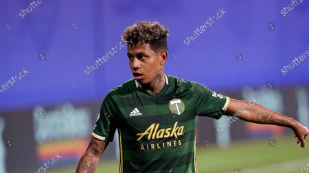 Portland Timbers forward Andy Polo gestures to a teammate during the second half of an MLS soccer match against the Philadelphia Union, in Kissimmee, Fla
