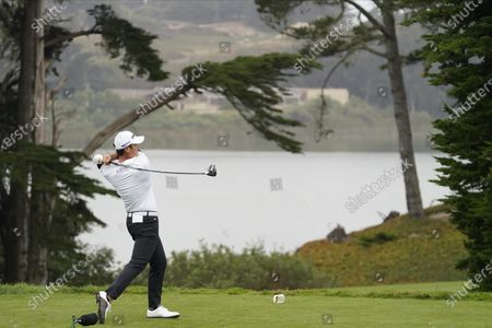 Andy Lee watches his tee shot on the fourth hole during the first round of the PGA Championship golf tournament at TPC Harding Park, in San Francisco