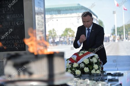 President of the Republic of Poland Andrzej Duda lays a wreath at the Tomb of Unknown Soldier during the ceremony of taking supreme command over the Polish Armed Forces as the Supreme Commander of the Republic of Poland at Pilsudski Square in Warsaw, Poland, 06 August 2020. Andrzej Duda begins his second term of office today. In the presidential election, Duda defeated Rafal Trzaskowski, the candidate of the Civic Coalition.