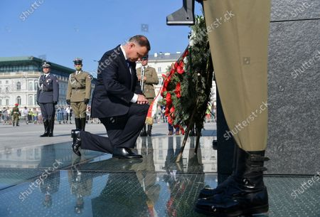 Stock Picture of President of the Republic of Poland Andrzej Duda (C) lays a wreath at the Jozef Pilsudski Monument during the ceremony of taking supreme command over the Polish Armed Forces as the Supreme Commander of the Republic of Poland at Pilsudski Square in Warsaw, Poland, 06 August 2020. Andrzej Duda begins his second term of office today. In the presidential election, Duda defeated Rafal Trzaskowski, the candidate of the Civic Coalition.