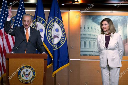 Senate Minority Leader Sen. Chuck Schumer of N.Y., joined by House Speaker Nancy Pelosi of Calif., speaks during a news conference on Capitol Hill in Washington