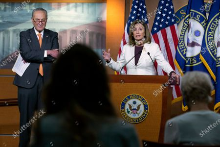 House Speaker Nancy Pelosi of Calif., joined by Senate Minority Leader Sen. Chuck Schumer of N.Y., speaks during a news conference on Capitol Hill in Washington