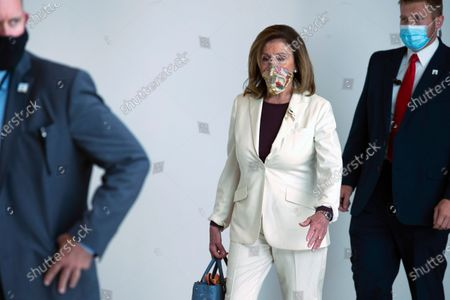 House Speaker Nancy Pelosi of Calif., walks to her office after speaking in a news conference on Capitol Hill in Washington