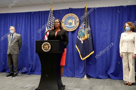 Flanked by charities bureau chief James Sheehan, left, and charities bureau enforcement section co-chief Emily Stern, right, New York State Attorney General Letitia James announces that the state is suing the National Rifle Association during a press conference, in New York. James said that the state is seeking to put the powerful gun advocacy organization out of business over allegations that high-ranking executives diverted millions of dollars for lavish personal trips, no-show contracts for associates and other questionable expenditures