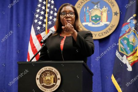 New York State Attorney General Letitia James takes a question from a reporter after announcing that the state is suing the National Rifle Association during a press conference, in New York. James said that the state is seeking to put the powerful gun advocacy organization out of business over allegations that high-ranking executives diverted millions of dollars for lavish personal trips, no-show contracts for associates and other questionable expenditures