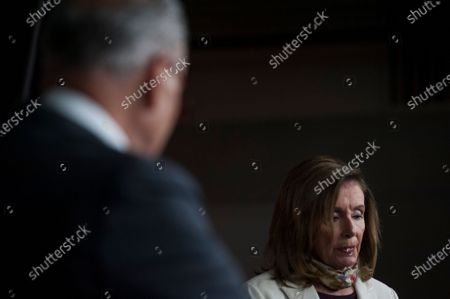 Speaker of the United States House of Representatives Nancy Pelosi (Democrat of California), right, and US Senate Minority Leader Chuck Schumer (Democrat of New York), left, hold a press conference on the status of the COVID-19 economic stimulus package currently in negotiations with The White House and members of the GOP leadership, at the US Capitol in Washington, DC.,.