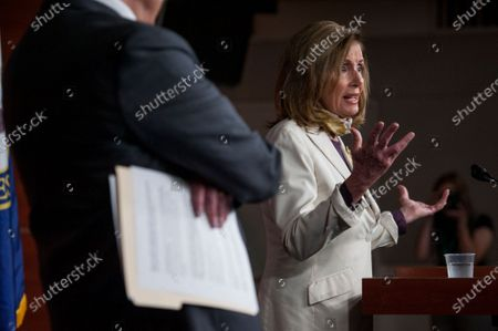 Speaker of the United States House of Representatives Nancy Pelosi (Democrat of California), right, offers remarks while joined by US Senate Minority Leader Chuck Schumer (Democrat of New York), left, during a press conference on the status of the COVID-19 economic stimulus package currently in negotiations with The White House and members of the GOP leadership, at the US Capitol in Washington, DC.,.