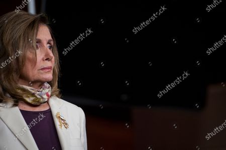 Speaker of the United States House of Representatives Nancy Pelosi (Democrat of California), listens while US Senate Minority Leader Chuck Schumer (Democrat of New York)offers remarks during a press conference on the status of the COVID-19 economic stimulus package currently in negotiations with The White House and members of the GOP leadership, at the US Capitol in Washington, DC.,.