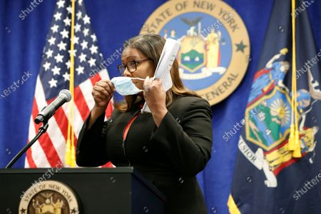 New York State Attorney General Letitia James dons her mask after announcing that the state is suing the National Rifle Association during a press conference, in New York. James said that the state is seeking to put the powerful gun advocacy organization out of business over allegations that high-ranking executives diverted millions of dollars for lavish personal trips, no-show contracts for associates and other questionable expenditures