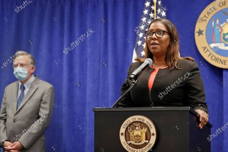 Flanked by her department's charities bureau chief James Sheehan, left, New York State Attorney General Letitia James announces that the state is suing the National Rifle Association during a press conference, in New York. James said that the state is seeking to put the powerful gun advocacy organization out of business over allegations that high-ranking executives diverted millions of dollars for lavish personal trips, no-show contracts for associates and other questionable expenditures
