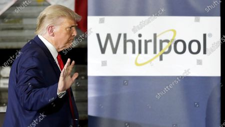 President Donald Trump waves after speaking during an event at the Whirlpool Corporation Manufacturing Plant, in Clyde, Ohio