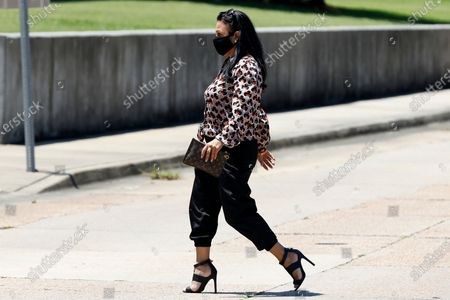 Stock Picture of Iris Villalon, 44, of Ocean Springs, crosses the street as she heads for the Thad Cochran United States Courthouse in Jackson, Miss., for an arraignment hearing in federal court on immigration crimes and other federal charges stemming from the largest single-state worksite enforcement action last year at a number of Mississippi poultry processing plants