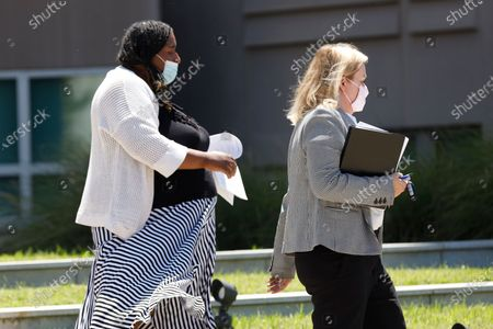 Stock Photo of Carolyn Johnson, left, exits the Thad Cochran United States Courthouse in Jackson, Miss., accompanied by attorney Bethany Johnson, after being arraigned in federal court on immigration crimes and other federal charges stemming from the largest single-state worksite enforcement action last year at a number of Mississippi poultry processing plants