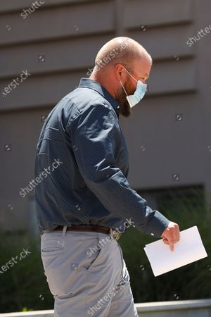 """Aubrey """"Bart"""" Willis exits the Thad Cochran United States Courthouse in Jackson, Miss., after his arraignment in federal court on immigration crimes and other federal charges stemming from the largest single-state worksite enforcement action last year at a number of Mississippi poultry processing plants"""