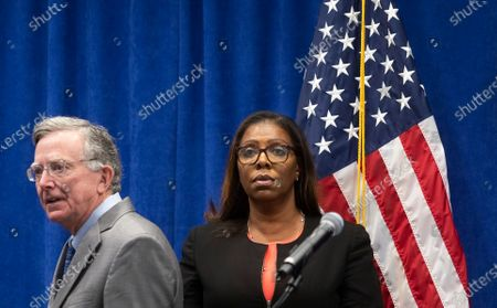 New York Attorney General Letitia James (R) and James Sheehan (L), Chief of the Charities Bureau, listen to a question during a press conference where James announced a lawsuit against the National Rifle Association alleging that leaders of the organization engaged in illegal financial activity in New York, New York, USA, 06 August 2020. As part of the lawsuit, which names, among others, Executive Vice-President Wayne LaPierre, James is looking to have the NRA dissolved as an organization.