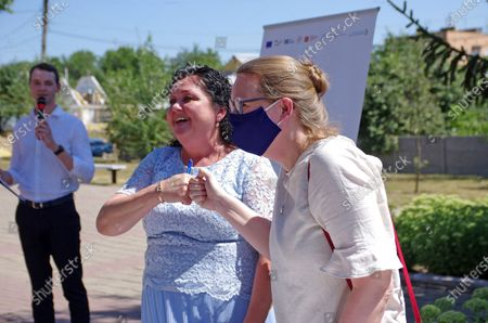 Sida Programme Director of U-LEAD with Europe Susanna Dellans (R) bumps fists with head of the territorial community Inna Koba during the signing of the memorandum of cooperation between the territorial community and the U-LEAD with Europe Programme on the construction of a centre for administrative services under a Swedish project, Novi Sanzhary urban-type settlement, Poltava Region, central Ukraine.