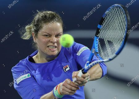 Stock Image of Belgium's Kim Clijsters returns the ball to Spain's Gabrine Muguruza during a match of the Dubai Duty Free Tennis Championship in Dubai, United Arab Emirates. Past U.S. Open champions Kim Clijsters and Andy Murray received wild-card invitations for the Grand Slam tournament