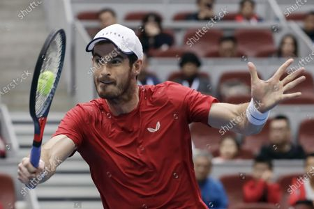 Andy Murray of Britain hits a shot against Dominic Thiem of Austria during their men's singles quarterfinal match in the China Open tennis tournament at the Diamond Court in Beijing. Past U.S. Open champions Kim Clijsters and Andy Murray received wild-card invitations for the Grand Slam tournament