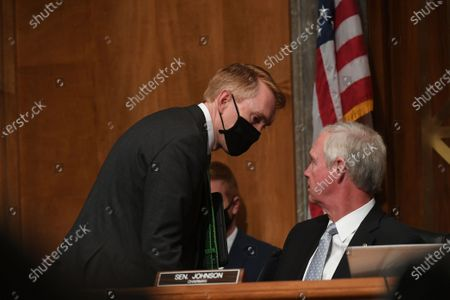 United States Senator James Lankford (Republican of Oklahoma), left, speaks with US Senator Ron Johnson (Republican of Wisconsin), Chairman, US Senate Committee on Homeland Security and Government Affairs during the hearing where acting US Secretary of Homeland Security Chad F. Wolf, is appearing before the committee in Washington D.C. to explain the use of federal agents during protests in Portland, Oregon.