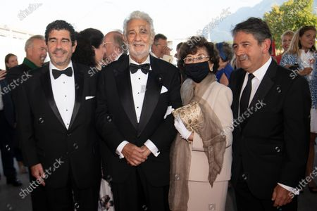 Stock Photo of Spanish tenor Placido Domingo (2-L), his wife Marta Domingo (2-R), and sons Alvaro Maurizio Domingo (L) and Placido Domingo Jr. (R), arrive for the 'Oesterreichische Musiktheaterpreis' (Austrian Music Theatre Award) gala at the Salzburg Airport, in Salzburg, 06 August 2020. Domingo is honored with the 2020 Austrian Music Theatre Lifetime Achievement Award at the event.