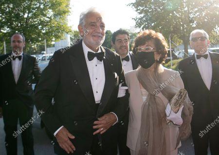 Spanish tenor Placido Domingo (L) and his wife Marta Domingo arrive for the 'Oesterreichische Musiktheaterpreis' (Austrian Music Theatre Award) gala at the Salzburg Airport, in Salzburg, 06 August 2020. Domingo is honored with the 2020 Austrian Music Theatre Lifetime Achievement Award at the event.