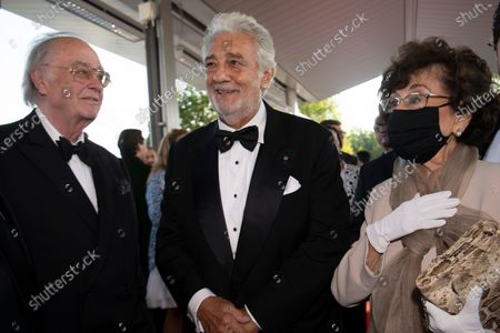 Spanish tenor Placido Domingo (C), his wife Marta Domingo (R), and German tenor Rene Kollo (L) arrive for the 'Oesterreichische Musiktheaterpreis' (Austrian Music Theatre Award) gala at the Salzburg Airport, in Salzburg, 06 August 2020. Domingo is honored with the 2020 Austrian Music Theatre Lifetime Achievement Award at the event.