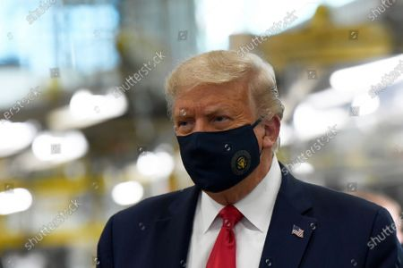 President Donald Trump wears a mask as he tours the Whirlpool Corporation facility in Clyde, Ohio