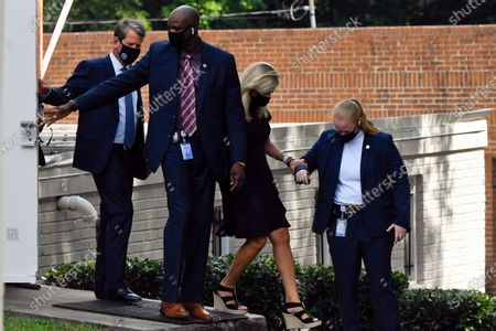Stock Picture of Georgia Gov. Brian Kemp, left, leaves a private viewing for Herman Cain, in Atlanta. Cain, a former Republican presidential candidate, radio host, and entrepreneur died on July 30, after being hospitalized with COVID-19 and will be laid to rest this week. He was 74