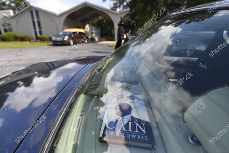 Book with Herman Cain on the cover is shown in the back window of a car in the parking lot of a mortuary where a public viewing for Herman Cain is occuring, in Atlanta. The book details his promotion of a simpler tax policy which he ran on during the Republican's 2012 United States presidential election bid. Cain died on July 30 after being hospitalized with COVID-19 and will be laid to rest this week. He was 74