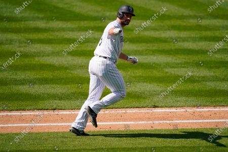 Colorado Rockies' Daniel Murphy celebrates a two run home run against the San Francisco Giants during the seventh inning of a baseball game, in Denver