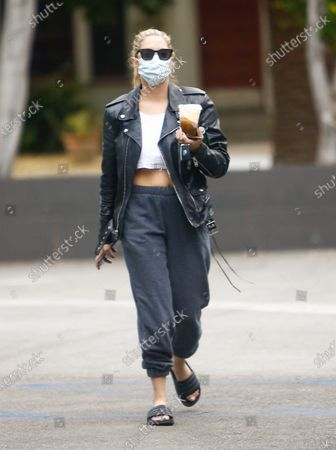 Ashley Benson seen wearing a mask and carrying a Starbucks coffee