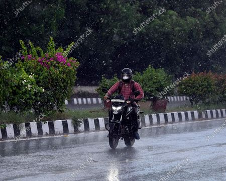 Commuters out in the rain at Aruna Asif Ali Road on August 6, 2020 in New Delhi, India.