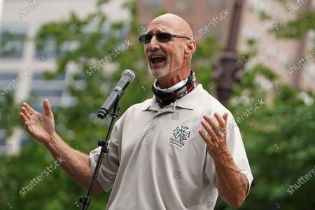 IATSE Local 8 head Michael Barnes speaks as workers from the entertainment industry hit hard by the COVID-19 pandemic participate in a March for Awareness, organized by the International Alliance of Theatrical Stage Employees (IATSE) Local 8 Stagehands