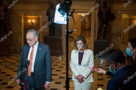 Speaker of the United States House of Representatives Nancy Pelosi (Democrat of California) and US Senate Minority Leader Chuck Schumer (Democrat of New York) talk with reporters following a meeting with White House Chief of Staff Mark Meadows, and US Secretary of the Treasury Steven T. Mnuchin regarding the COVID-19 economic stimulus package deal which lasted over three hours at the US Capitol in Washington, DC.,.