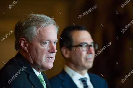 White House Chief of Staff Mark Meadows, left, and United States Secretary of the Treasury Steven T. Mnuchin, talk to reporters following a meeting with Speaker of the US House of Representatives Nancy Pelosi (Democrat of California), and US Senate Minority Leader Chuck Schumer (Democrat of New York) regarding the COVID-19 economic stimulus package deal which lasted over three hours at the US Capitol in Washington, DC.,.