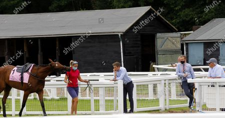Harry Derham [for Paul Nicholls] and Donald McCain surveying the paddock and their runners at Cartmel.