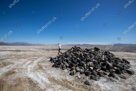Travelers Monument, a large and seemingly random pile of rocks in the middle of the Mojave Road traversing the dry Soda Lake south of Zzyzx on Wednesday, April 1, 2020 in San Bernardino County, CA. Four-wheelers bring rocks across the lake and deposit them here along their journey. (Brian van der Brug / Los Angeles Times)