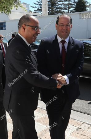 Tunisia's Prime Minister-designate Hichem Mechichi (L) welcomes  former head of government, Youssef Chahed( R) during consultations as part of the formation of the next government in Tunis, Tunisia, 07 August 2020. The designated head of government, Hichem Mechichi, is continuing the consultations within the framework of the formation of the next government. He will talk to the former heads of government, Hamadi Jebali, Ali Laarayedh, Habib Essid and Youssef Chahed. According to article 89 of the Constitution, the personality who will be tasked with forming the next government will have one month to train his team and present it to the Assembly of People's Representatives, the deadline of 25 August 2020.