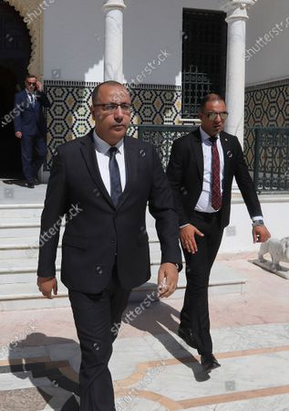 Tunisia's Prime Minister-designate Hichem Mechichi (C) before consultations as part of the formation of the next government in Tunis, Tunisia, 07 August 2020. The designated head of government, Hichem Mechichi, is continuing the consultations within the framework of the formation of the next government. He will talk to the former heads of government, Hamadi Jebali, Ali Laarayedh, Habib Essid and Youssef Chahed. According to article 89 of the Constitution, the personality who will be tasked with forming the next government will have one month to train his team and present it to the Assembly of People's Representatives, the deadline of 25 August 2020.