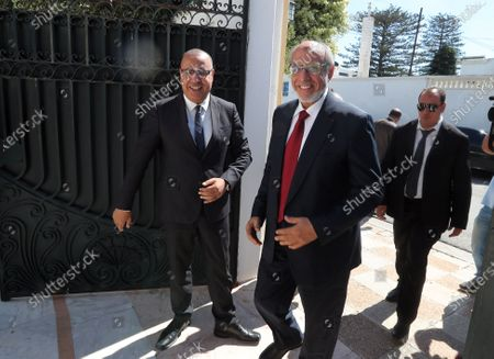 Tunisia's Prime Minister-designate Hichem Mechichi (L) welcomes  former head of government, Hamadi Jebali (C) during consultations as part of the formation of the next government in Tunis, Tunisia, 07 August 2020. The designated head of government, Hichem Mechichi, is continuing the consultations within the framework of the formation of the next government. He will talk to the former heads of government, Hamadi Jebali, Ali Laarayedh, Habib Essid and Youssef Chahed. According to article 89 of the Constitution, the personality who will be tasked with forming the next government will have one month to train his team and present it to the Assembly of People's Representatives, the deadline of 25 August 2020.