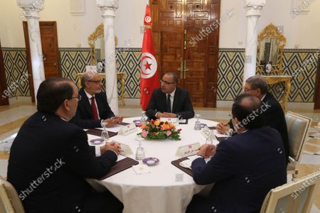 Stock Image of Tunisia's Prime Minister-designate Hichem Mechichi,( C) with former heads of government, Hamadi Jebali (2-L), Youssef Chahed( ( L) Ali Laarayedh (R)  Habib Essid (2-R) during consultations as part of the formation of the next government in Tunis, Tunisia, 07 August 2020. The designated head of government, Hichem Mechichi, is continuing the consultations within the framework of the formation of the next government. He will talk to the former heads of government, Hamadi Jebali, Ali Laarayedh, Habib Essid and Youssef Chahed. According to article 89 of the Constitution, the personality who will be tasked with forming the next government will have one month to train his team and present it to the Assembly of People's Representatives, the deadline of 25 August 2020.